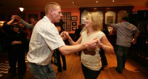 The hormone-fuelled optimism of Lisdoonvarna: Joe Copse from Newcastlewest and Maura O'Connor from Galway enjoying a dance at the Matchmaker Bar. Photograph: Eamon Ward