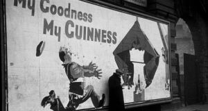 A Guinness advertisement in Elephant and Castle, London. Photograph: Bert Hardy/Picture Post/Getty Images