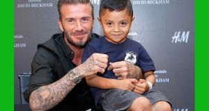 David Beckham with a fan at the launch of David Beckham's H&M Modern Essentials Collection: Hennes & Mauritz fell 2.9 per cent after the fashion retailer reported worse-than-estimated revenue growth in September. Photograph: Rachel Murray/Getty Images for H&M