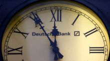 Clock at a Deutsche Bank branch: the bank's stock rallied  on Friday on reports that the fine it may have to pay would be nearer $5.4 billion than the $14 billion first mooted. Photograph: Kai Pfaffenbach/Reuters