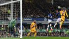 Christian Benteke rises to score Crystal Palace's equaliser against Everton at Goodison Park. Photograph: Reuters