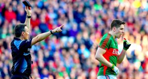Referee Maurice Deegan black cards Lee Keegan of Mayo. Photo: James Crombie/Inpho