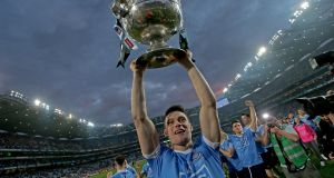 Diarmuid Connolly celebrates with the Sam Maguire Cup after Dublin's victory over Mayo in the All-Ireland SFC Final Replay at Croke Park. Photograph:  Donall Farmer/Inpho