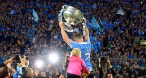 Philip Mc Mahon lifts the Sam Maguire Cup  to the Hill  after  the Dublin win over Mayo. at Croke Park  Photograph: Cyril Byrne / THE IRISH TIMES