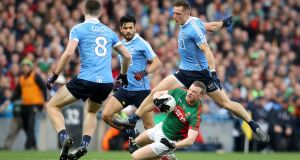 Dublin's Paul Flynn fouls Colm Boyle of Mayo. Photo: Ryan Byrne/Inpho