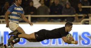 All Blacks scrumhalf TJ Perenara dives to score during his side's Rugby Championshsip win over Argentina. Photograph: Afp