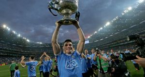 Diarmuid Connolly holds the Sam Maguire aloft in front of Hill 16. Connolly's penalty, fired past Mayo's substitute goalkeeper David Clarke, gave Dublin a lead they would not surrender. Photograph: Donall Farmer/Inpho