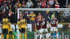 Laurent Koscielny turns the ball home in the 93rd minute to give Arsenal a last-gasp win away to Burnley. Photograph: Reuters