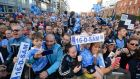 Fans cheer the Dublin team during the homecoming celebrations at Smithfield Plaza, Dublin. Photograph: Dara MacDónaill/The Irish Times