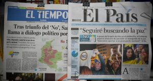 Newspapers announce the results of the referendum that surprisingly said No to the peace agreement between the Colombian government and the Farc guerrillas in Cali, Colombia. Photograph: Luis Robayo/AFP/Getty Images