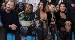 US reality television star Kim Kardashian (centre) with her husband Kanye West, at the presentation of the Spring/Summer 2017 collection by Off-White during the Paris Fashion Week, in Paris. Photograph: Caroline Blumberg/EPA