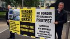 Campaigners from a group called Border Communities Against Brexit outside Belfast's High Court where a legal challenge to Brexit is taking place. Photograph: Michael McHugh/PA Wire
