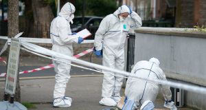 Garda forensic team at the site of a multiple stabbing on South Circular Road, Dublin. Photograph: Dave Meehan/The Irish Times