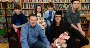 Kerrie Prendergast, a graduate from An Cosan's Virtual Community College,  with her husband, Martin, and children Oisin, Odhran, Fionn, Fiadh and Muira. Photograph: Dara Mac Dónaill / The Irish Times