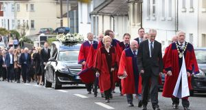 Galway City Councillors form a guard of honour as the remains of Bobby Molloy are taken to the New Cemetery in Galway. Photograph: Joe O'Shaughnessy.