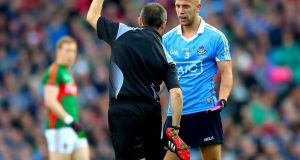 Referee Maurice Deegan black-carding Dublin defender Jonny Cooper during the All-Ireland final replay against Mayo. Photograph: INPHO/James Crombie