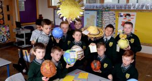 Fourth-class boys at St Laurence O'Toole CBS during a class on the solar system. The school uses art as a way of teaching a range of subjects. Photograph: Cyril Byrne/The Irish Times