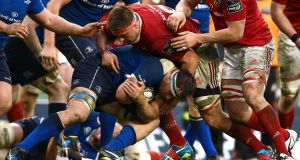 Leinster's Rhys Ruddock is tackled by Munster's  CJ Stander at the Aviva last April. Photograph: James Crombie/Inpho
