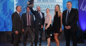 Liam Kavanagh, MD The Irish Times presenting The Irish Times Innovation 2016 overall award to Eamonn Boland, Barry Lunn, Marie Bourke, Valerie Somers and Denver Humphrey of Arralis