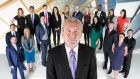 Watch your back: Alan Sugar with this year's batch of Apprentices