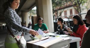 A voter casts her ballot in the referendum on a peace accord  between the Farc and the Colombian state last Sunday. The  referendum was defeated by a narrow margin. Photograph: Mario Tama/Getty Images