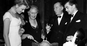 Agatha Christie cuts the cake watched by Mary Law, left, to mark the sixth anniversary of her play The Mousetrap. The world's longest running play was originally written as a 20-minute radio drama, Three Blind Mice. The film rights to The Mousetrap were sold shortly after the play opened but with the proviso that the play must close before filming began. Photograph: Bentley Archive/ Popperfoto/ Getty Images