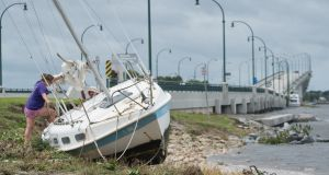 A sailboat washed ashore by Hurricane Matthew at the Jensen Beach Causeway Park in Jensen Beach, Florida. Hurricane Matthew stayed just far enough offshore to spare Central Florida a direct hit, but remained a Category 3 storm moving north along the Atlantic coast. Photograph: Angel Valentin/New York Times