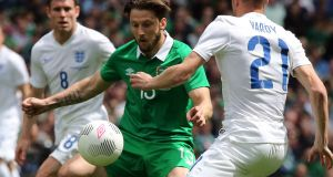 Harry Arter in action in the internatonal friendly against England's Jamie Vardy   at the Aviva Stadium in June 2015. Photograph: Paul Faith/AFP/Getty Images