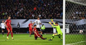 Thomas Müller scores his second and Germany's  third goal in the  World Cup qualifier against the  Czech Republic at Volksparkstadion  in Hamburg. Photograph: Stuart Franklin/Bongarts/Getty Images