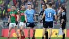 "Dublin's John Small is yellow-carded by referee Maurice Deegan in the All-Ireland final. When Deegan was chosen to referee the the match he was basically thrown into a bear-pit and told ""good luck now"". Photograph: INPHO/Ryan Byrne"