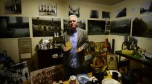 Terry Fagan of the North Inner City Folklore Project with some of the items stored in a boarded up flat in Sean McDermott Street. Photograph: Bryan O'Brien