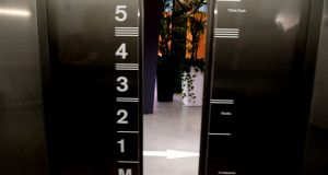 Design detail: elevators have Ogham characters and what's on each floor marked on the doors. Photograph: Cyril Byrne