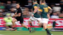 New Zealand's Israel Dagg running with the ball while South Africa's Jaco Kriel tries to tackle him during the Rugby Championship test match played at the Kings Park Stadium, Durban. Photograph: EPA