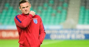 England captain Wayne Rooney walks on the pitch on the eve of the World Cup 2018 football qualification match in Ljubljana. Photograph: Getty Images