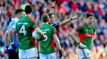 Mayo's Lee Keegan is black carded by referee Maurice Deegan in the All-Ireland football final replay. Photograph: James Crombie/Inpho