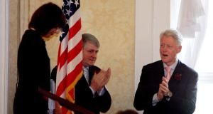 Denis O'Brien and Bill Clinton applaud Mary Donohoe, project founder, at a fundraising breakfast for The Rose Project-Aids in Africa, in Dublin in 2005. Photograph: Eric Luke