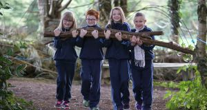 St Oliver's national school, Killarney, Co Kerry: third-class pupils Wikoria Sloniany, Killian Sugrue, Cleo O'Connell and Jocelyn Hickey clearing the school's woodland to have their own forest playground.  Photograph: Valerie O'Sullivan