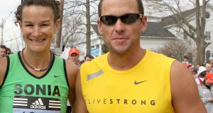 I only met Lance once, briefly, at the start of the 2008 Boston Marathon, when someone asked could they take a photo.