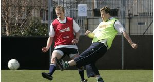April 2007: The then Green Party TD Paul Gogarty (right) and former Meath Gaelic footballer Graham Geraghty taking part in a five-a-side football match in aid of Goal in Ringsend, Dublin. Photograph: Dara Mac Dónaill/The Irish Times.