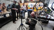 Working on a bicycle in Athy Men's Shed. Founded in response to the rising rates of mental health problems and isolation affecting men around the country they are spaces where men can come together to work on meaningful activities.  Photograph: James Flynn