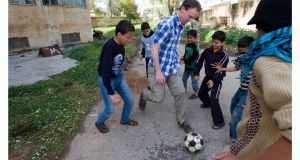 Barry Andrews with children in Syria: he has stepped down as CEO of Goal which is one of a number of aid agencies being investigated by the US Office of Inspector General. Photograph: courtesy of Goal