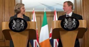 "The Taoiseach with  Theresa May at 10 Downing Street. The prime minister, Kenny said, ""was categoric about the retention of the Common Travel Area and no return to a hard Border"". Photograph: Reuters/Stefan Rousseau/Pool"