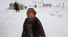 Catching cold while ice-fishing in Mongolia