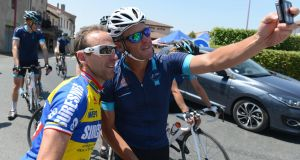 Lance Armstrong poses for a selfie as he rides with Cure Leukaemia charity riders during stage thirteen of the One Day Ahead - Le Tour 2015 on July 16, 2015 in Rodez, France. Photo: Sam Bagnall/Getty Images