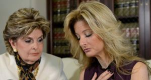 Summer Zervos, a former contestant on the TV show The Apprentice, reacts next to lawyer Gloria Allred (left) while speaking about allegations of sexual misconduct against Donald Trump during a news conference in Los Angeles on Friday. Photograph:  Kevork Djansezian/Reuters