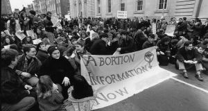 A demonstration in February 1992 outside Government Buildings against the High Court injunction forbidding a 14-year-old rape victim from obtaining an abortion in Britain. The banner includes a telephone number which was deleted by The Irish Times, in compliance with the High Court ruling of December 1986, which found that the provision of assistance, including information, to a pregnant woman seeking an abortion was in breach of Article 40 of the Constitution. Photograph: Eric Luke