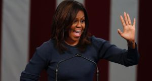 "Michelle Obama: The first lady says the stories about Trump remind women ""of stories we heard from our mothers and grandmothers about how, back in their day, the boss could say and do whatever he pleased to the women in the office."" Photograph: EPA/CJ Gunther"