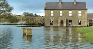 A flooded farmhouse at Carrabane near Thoor Ballylee in south Co Galway. Note the near-submerged posts of the front gate in the foreground. Photograph: Joe O'Shaughnessy