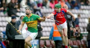 Gort's Pakie Lally is pursued by David Sherry of St. Thomas' during his side's Galway SHC final defeat. Photograph: Inpho