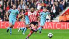 Charlie Austin scores from the spot during Southampton's win over Burnley. Photograph: Getty